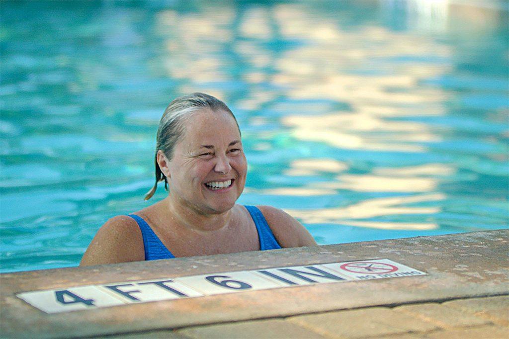 Woman smiling at pool at Hilton Head Health