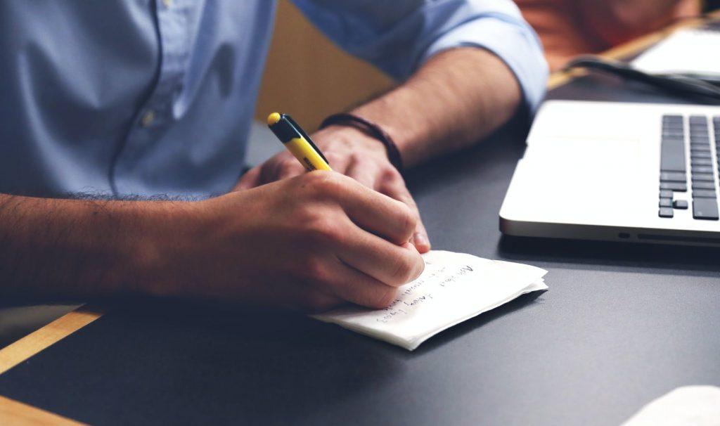 Man writing a to-do list